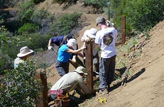 Preserve Partners installing a fence at Sierra Azul